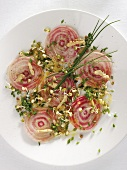 Sliced beetroot with nuts and sprouts