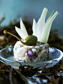 Clam tartare with onions and caper berries