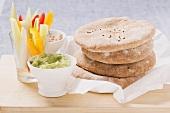 Wholemeal pita bread with guacamole, tuna dip & raw vegetables