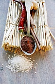 Assorted spices on a straw mat