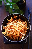 Carrot matchsticks in a small bowl