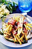 Grilled vegetables with bacon-wrapped beans