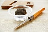 Black truffle (Perigord truffle) in a small glass dish