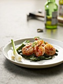 Cooked prawns with spinach and spring onions
