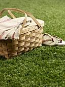 Picnic basket and flip-flops