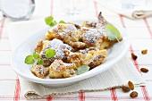Kaiserschmarren (shredded pancake) with icing sugar & raisins