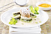 Kiwi fruit dessert with coconut sauce