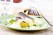 Matjes herring fillets with apple on couscous