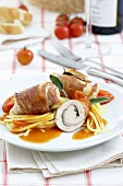 Saltimbocca roulades with spaghetti and tomato sauce