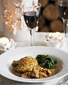 Lamb ragout with spinach and cheese scone