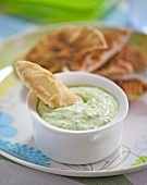 Pitta bread with broccoli sauce