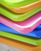 Stacked coloured plastic lids