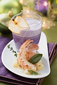 Red cabbage foam soup with pear and langoustines