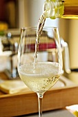 Pouring sparkling wine into a glass