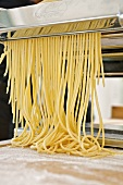 Making spaghetti with a pasta maker