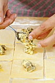 Making ricotta and herb ravioli