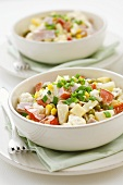 Mixed vegetable salad with ham, pineapple, cheese, mayonnaise