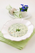 Dill soup with edible flowers and a posy of forget-me-nots