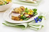 Pork fillet in herb crust with mixed salad