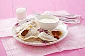 Plum ravioli and cream