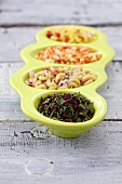 Four instant soups with dried vegetables and herbs