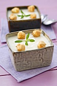 Cream of asparagus soup with tarragon and choux pastry balls