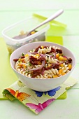 Pasta salad with dried tomatoes, onions and yellow pepper