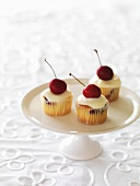 Mini cherry cupcakes on a cake stand
