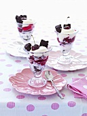 Three glasses of parfait with cherries and brownies