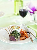 Rack of lamb with herb crust, potato gratin and carrots