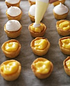 Making lemon meringue tartlets