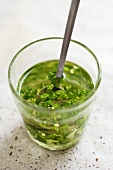 Parsley and garlic marinade in a glass