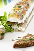 Boiled beef and vegetables in jelly with horseradish cream