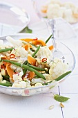 Cauliflower, bean and carrot salad with pine nuts and chilli