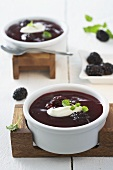 Blackberry soup with cream and mint