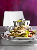 Sea bream fillets with artichoke hearts and olives