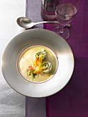 Vegetable soup with saffron and small turbot rolls