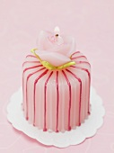 Petit four with rose candle