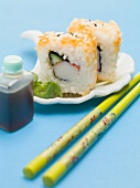 Inside-out rolls with soy sauce and chopsticks