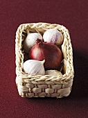 Onion and garlic in a small basket