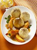 Quark dumplings with peach slices