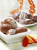 Chocolate shells with orange and cardamom filling