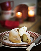 Apple dumpling (apple baked in pastry) with whipped cream