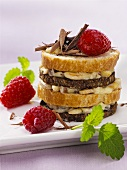 Multi-layered sandwich with raisin & almond butter filling, raspberries