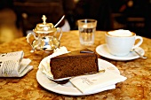 A piece of Sachertorte & Wiener Melange (coffee) in coffee shop