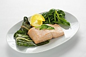 Steamed salmon steak with spinach and chard