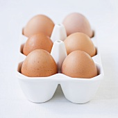 Fresh eggs in porcelain egg holder