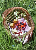 Basket of desserts in grass