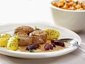 Pork fillet with parsley potatoes and plums