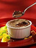 Chocolate soufflé with orange segments